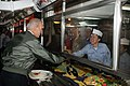 US Navy 090514-N-4133B-581 Vice President, Joe Biden shakes hands with Culinary Specialist 3rd Class Gabriella De Los Santos on the mess decks aboard the Nimitz-class aircraft carrier USS Ronald Reagan (CVN 76).jpg