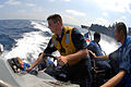 US Navy 090930-N-2600H-074 Boatswain's Mate Seaman Joshua Frick operates the controls of a rigid hulled inflatable boat off the starboard side of the guided-missile destroyer USS Sampson (DDG 102).jpg