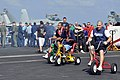 US Navy 091211-N-8421M-035 Sailors enjoy tricycle races during a steel beach picnic aboard the aircraft carrier USS Nimitz (CVN 68).jpg