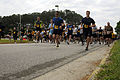 US Navy 100423-N-9180M-070 Chris Petrock and Aviation Structural Mechanic Airman Apprentice Matthew Cerasuolo lead the pack of more than 500 runners during a 5-kilometer run at Naval Station Oceana.jpg