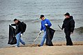 US Navy 100505-N-9917S-014 Sailors assigned to the guided-missile cruiser USS Vicksburg (CG 69) and the Lithuanian navy clean the Melrange Municipality beach in Klaipeda, Lithuania.jpg