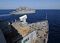 US Navy 100509-N-1082Z-121 The Military Sealift Command dry cargo and ammunition ship USNS Robert E. Peary (T-AKE 5) pulls away from the amphibious dock landing ship USS Ashland (LSD 48).jpg