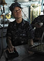 US Navy 110510-N-DU438-317 Quartermaster Seaman Barbara Flores, assigned to the guided-missile cruiser USS Gettysburg (CG 64), stands watch on the.jpg