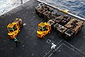 US Navy 110707-N-IC111-048 Sailors move cargo pallets on an aircraft elevator aboard the aircraft carrier USS Ronald Reagan (CVN 76) to transport t.jpg