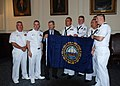 US Navy 110729-N-ZZ999-070 New Hampshire Governor John Lynch poses with a New Hampshire state flag presented by Sailors assigned to USS New Hampshi.jpg