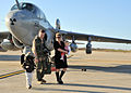 US Navy 111106-N-FJ200-121 Sailor walks with family on flight line after deployment.jpg