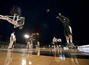 US Navy 111110-N-DR144-848 Michigan State University basketball player Alex Gauna shoots during a practice in the basketball arena on the flight de.jpg
