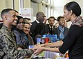 US Navy 111216-F-ZE674-348 First lady Michelle Obama shakes hands with Lance Cpl. Aaron Leeks and other Marines during a Toys-for Tots community se.jpg