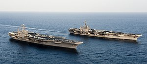 US Navy 120119-N-OY799-174 The Nimitz-class aircraft carriers USS John C. Stennis (CVN 74) and USS Abraham Lincoln (CVN 72) transit during a turnov.jpg