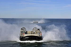 US Navy 120130-N-ZZ999-091 A group of landing craft air cushions (LCACs) from Assault Craft Unit (ACU) 4 approach the amphibious assault ship USS W.jpg