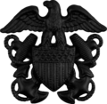 US Navy officer subdued cap badge.png