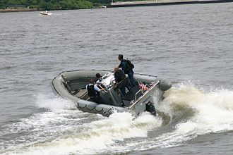 Rigid-hulled inflatable boat - RHIB deployed from a US Navy Destroyer operating in a littoral area
