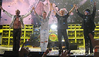 Van Halen - From left to right: David Lee Roth (vocals), Eddie Van Halen (guitar), Alex Van Halen (drums), and Wolfgang Van Halen (bass guitar)