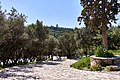 View of the Philopappos Hill and its monument from next to the Odeon of Herodes Atticus.jpg