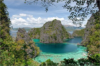 Palawan - A lagoon in El Nido (left). Coron Island (right).