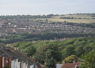 Elm Grove, Brighton - Extensive westward and northward views are possible from the Elm Grove area.  From the junction of Elm Grove and Ryde Road, the Hollingdean estate and Hollingbury Hill can be seen.  The well-wooded area in the foreground is part of Brighton's chain of Victorian cemeteries.