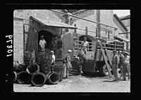 Vintage activities at Richon-le-Zion, Aug. 1939. Unloading grapes at the wine cellars LOC matpc.19773.jpg
