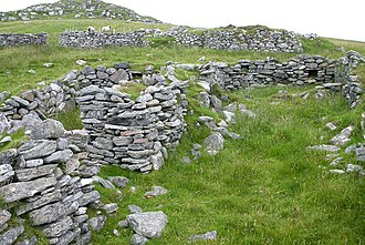 Scotland - Ruined croft houses at Fuaigh Mòr in the Outer Hebrides. The inhabitants were evicted during the Highland Clearances.
