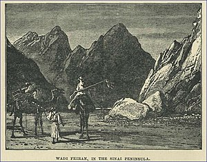 Wâdy Feirân. The rock supposed to have been struck by Moses is in the right-hand forground. The Arabs call it Hesy el Khattatin (NYPL b10607452-80755).jpg