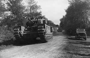 Operation Wellhit - A Churchill tank leads a troop of Sherman flail tanks of British specialized 79th Armoured Division during the assault on Boulogne, September 1944