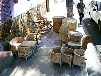 Nahuizalco - Local wicker furniture on sale in the street of Nahuizalco