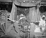 Work on Spitfire Merlin engine at Maison Blanche WWII IWM CNA 3303.jpg