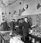 Wrens and ratings of the Royal Navy at work in a Fleet Mail Office at a naval shore establishment in England during 1944. D22591.jpg