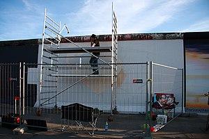 East Side Gallery - Dimitri Vrubel during restoration in June 2009