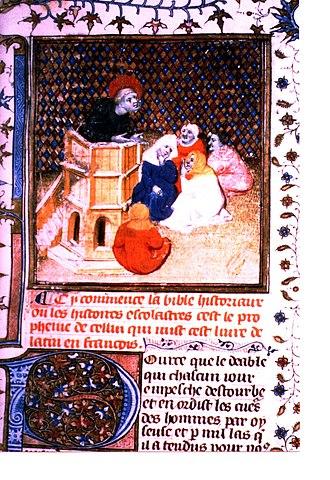 """Bible Historiale - Folio 1 du Ms Ars. 5057: A preacher preaches to old ladies. """"Pource que le Deable qui chascun jour destourbe et enordut le coeur des hommes par oyseuse (ie: """"paresse"""") et par mille lacs (i.e. """"lacets, cordes"""") qu'il a tendus...""""(Because the devil, who every day troubles and soils men's hearts with sloth and by a thousand traps...)"""