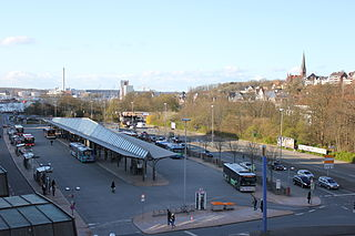 Bus station structure, larger than a bus stop, where city or intercity buses stop to pick up and drop off passengers