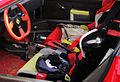 """ 11 - Ferrari F40 - inusual use of a supercar - woman bags on racing seats.jpg"