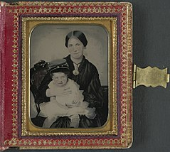 (Unidentified woman, possibly Mrs. James Shields, in mourning dress and brooch showing Confederate soldier and holding young boy wearing kepi) (LOC) (14379161687).jpg