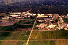 Aerial shot of campus buildings surrounded by agricultural land