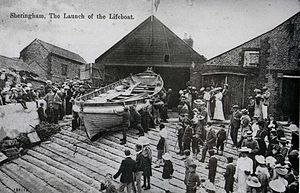 Sheringham Lifeboat Station - Image: 1904 Postacard of the Henry Ramey Upcher outside her boathouse