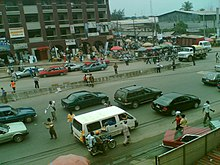 A picture of the Port Harcourt City centre from a highway with traffic and high rises in the distance
