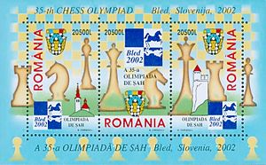 35th Chess Olympiad - A 2002 Romanian stamp sheet featuring the logo of the 35th Chess Olympiad (center-top)