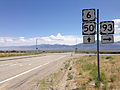 2014-08-09 11 30 05 Signs on eastbound U.S. Routes 6 and 50 and southbound U.S. Route 93 about 63.9 miles east of the Nye County line near Majors Place, Nevada.JPG