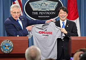 Japan Self-Defense Forces - United States Secretary of Defense Chuck Hagel presents Japan's Minister of Defense Itsunori Onodera with a University of Nebraska Omaha tennis shirt at the joint press availability at the United States Department of Defense Washington, DC on July 11, 2014. DoD photo taken by Casper Manlangit (Released)