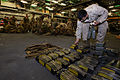 20151025-UK-USMC cleaning weapons o-b HMS OCEAN, Trident Juncture 15 (22307730998).jpg