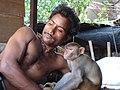 2441 -Indian with monkey friend in Delhi market (57703372).jpg
