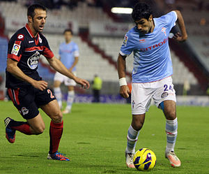Carlos Marchena - Marchena (left) challenging Augusto Fernández in the Galician derby in 2012