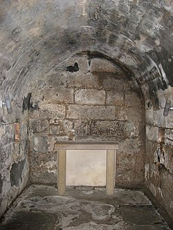 An underground stone lined crypt.