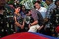8-31-16 President Rodrigo R. Duterte hugs a child as he condoles with the family of slain soldiers.jpg