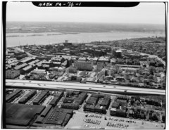 AERIAL VIEW LOOKING SOUTHEAST. ARSENAL RUNS FROM LEFT TO RIGHT ACROSS CENTER OF PICTURE. ORIGINAL ARSENAL BORDERS PARADE GROUND AT RIGHT. - Frankford Arsenal, South of Tacony HAER PA,51-PHILA,693-1.tif