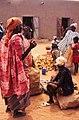 ASC Leiden - W.E.A. van Beek Collection - Dogon markets 07 - Women with children and cassava roots at Sangha market, Mali 1992.jpg