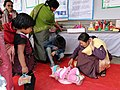 A Baby being weighted in the ICDS Stall, at the Bharat Nirman Public Information Campaign, at Takyel, Imphal West, Manipur on February 18, 2011.jpg