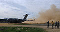 A C-17 Globemaster III cargo plane from Travis Air Force Base, takes off from an airfield as part of the Army Reserve Warrior Exercise at Fort Hunter Liggett, Calif., March 19, 2013 130319-A-VX503-477.jpg
