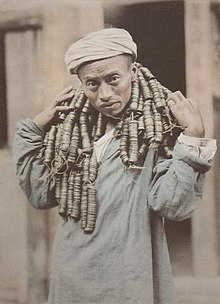 A Sichuanese Man Carrying 13,500 Cash Coins.jpg