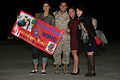 A U.S. Marine with Marine All-Weather Fighter Attack Squadron 224 takes a photo with his family after a six-month deployment to the Western Pacific in Support of the Unit Deployment Program aboard Marine Corps 130322-M-EK666-003.jpg