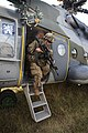 A U.S. Soldier, 1st Battalion, 503rd Infantry Regiment, 173rd Airborne Brigade Combat Team exits a Mil Mi-17.jpg